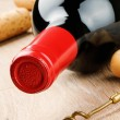 Bottle of red wine on wooden table — Stockfoto