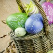 Basket with colorful Easter eggs — Stock Photo
