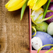 Colorful Easter eggs in festive setting — Stock Photo
