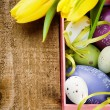 Colorful Easter eggs in festive setting — Stock Photo #21863399