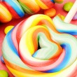 Colorful lollipops and smarties — Stock Photo