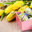 Colorful Easter eggs in open gift box — Stock Photo