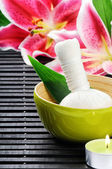 Spa setting with pink lily — Stock Photo