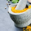 Royalty-Free Stock Photo: Mortar and pestle with curry powder