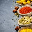 Colorful mix of spices on stone background - Stock Photo