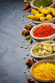 Colorful mix of spices on stone background — Stock Photo