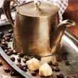Vintage coffee pot on silver tray - Stock Photo