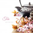 Asian tea pot with cherry blossom - Stock Photo