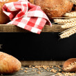 Traditional bread and rustic wooden board — Stock Photo