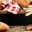 Traditional bread and rustic wooden board — Stock Photo #26862849