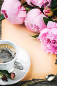 Frame with pink peonies and coffee — Stock Photo