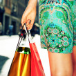 Young female holding shopping bags — Stock Photo