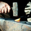 Stock Photo: Blacksmith at work