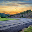 Landscape with curvy road at sunset — Stock Photo