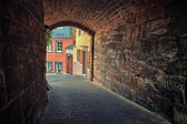 Arched pedestrian tunnel in small European city — Stock Photo