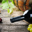 Bottle of red wine and fresh grape — Stock Photo