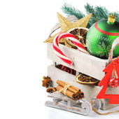 Old wooden box with colorful Christmas decorations — Stock Photo