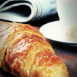 Breakfast with fresh croissant and coffee — Stock Photo