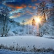 Sunset over winter forest lake — Foto Stock