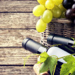 Bottles of red and white wine with fresh grape — Stock Photo #34437439