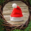 Santa hat in Christmas setting — Stock Photo
