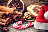 Christmas setting with festive spices and candy cane — Stock Photo