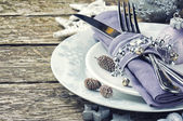 Christmas table setting in silver tone — Stock Photo