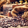Roasted coffee beans in vintage setting — Stock Photo