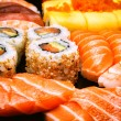 Sushi, sashimi and california rolls — Stock Photo
