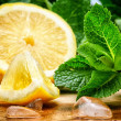 Fresh lemon, mint and ice — Stock Photo