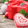 Christmas gift and festive ornaments — Stock Photo