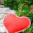 Vintage red heart in Christmas setting — Stock Photo