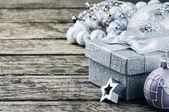 Christmas gift box and ornaments — Stock Photo