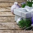 Christmas gift box and festive ornaments — Stock Photo