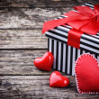 Stock Photo: Valentine's gift box with red hearts