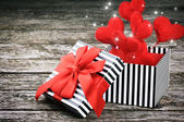 Valentine's gift box with red hearts — Stock Photo