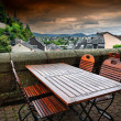 Cafe terrace in small European town — Stock Photo #38833931