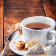 Stock Photo: Cup of black tea and cookie