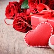 Red roses and Valentin's gift — Stock Photo
