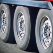 Truck wheels in motion — Stock Photo #39740373