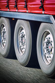 Truck wheels in motion — Stock Photo