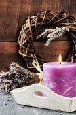 Fresh lavender flowers and scented candle — Stock Photo