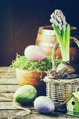 Easter setting with hyacinth and decorative eggs — Stock Photo