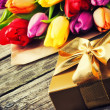 Multicolor tulips bouquet and gift box — Stock Photo #41543121