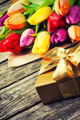 Multicolor tulips bouquet and gift box — Stock Photo