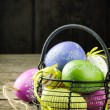 Easter decorative eggs in basket — Stock Photo