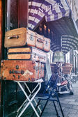 Antiques shop with vintage travel suitcases — Stock Photo