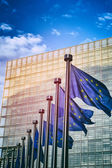 EU flags in front of European Commission in Brussels — Stock Photo