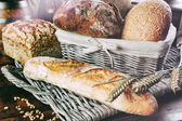 Freshly baked bread in countryside setting — Stock Photo