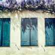 Old windows with blue shutters. — Stock Photo